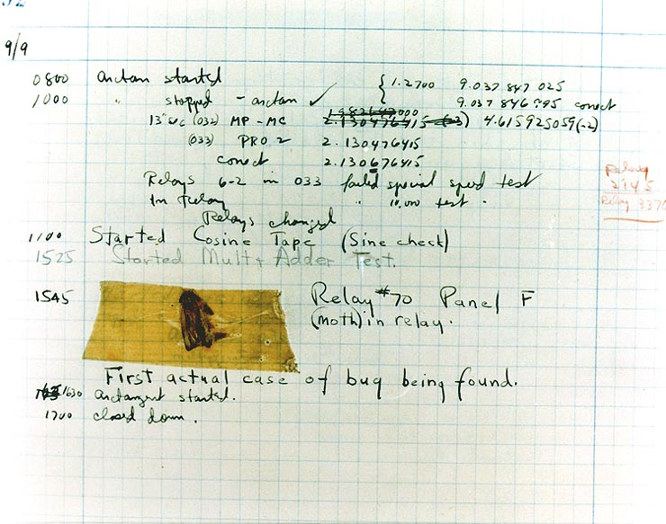 UNIVAC logbook with moth taped in